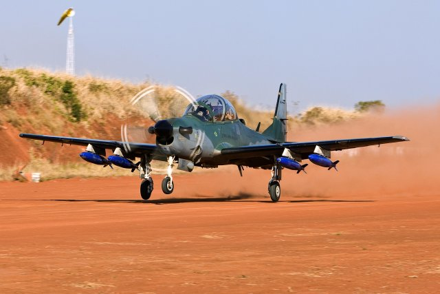 Embraer Defense & Security and the Ministry of Defence of the Republic of Ghana have signed a contract for the acquisition of five A-29 Super Tucano light attack and advanced training turboprops, the Brazilian aircraft manufacturer announced today at Paris Air Show 2015. The contract includes logistic support for the operation of these aircraft as well as the set-up of a training system for pilots and mechanics in Ghana that will provide the autonomy of the Ghana Air Force in preparing qualified personnel.
