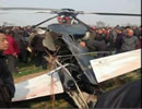 A military helicopter crashed in a farm in Northwest China's Shaanxi Province on Tuesday afternoon, and the two pilots have been sent to a nearby hospital, local authorities said on Tuesday.